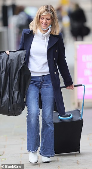 Stepping out: Kate stepped out with a suitcase and a clothes bag
