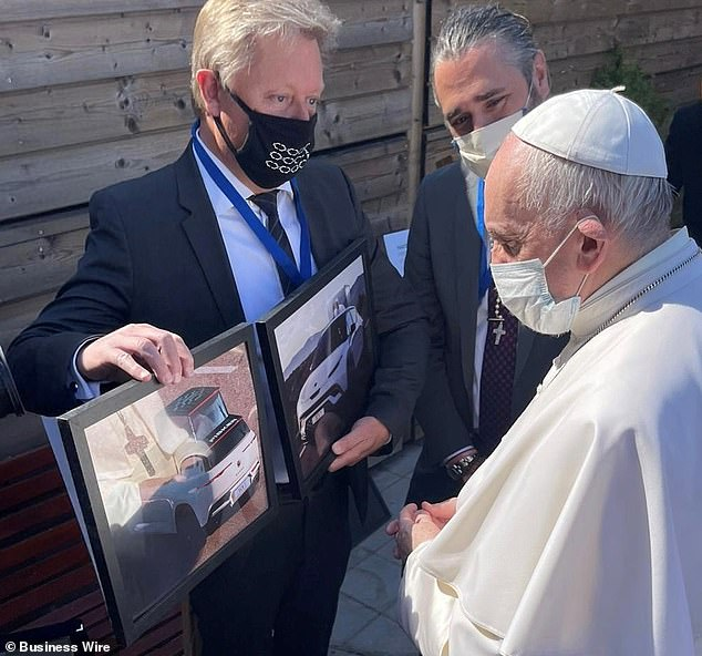 Fisker co-founder Henrik Fisker is showing Pope Francis what the custom made Ocean SUV will look like.