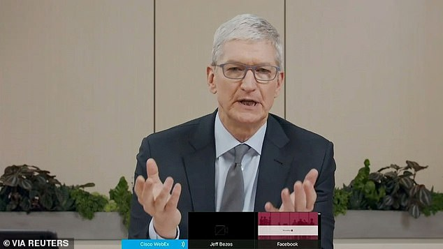Apple CEO Tim Cook took the witness stand on Friday to defend the company's iPhone app store against charges that it has grown into an illegal monopoly (file photo)