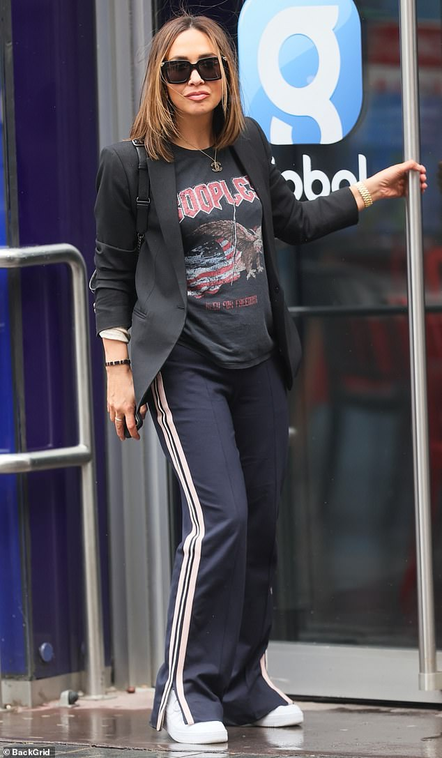 Edgy:Myleene's T-shirt featured an eagle and distressed American flag, while her tracksuit bottoms boasted splits on either side