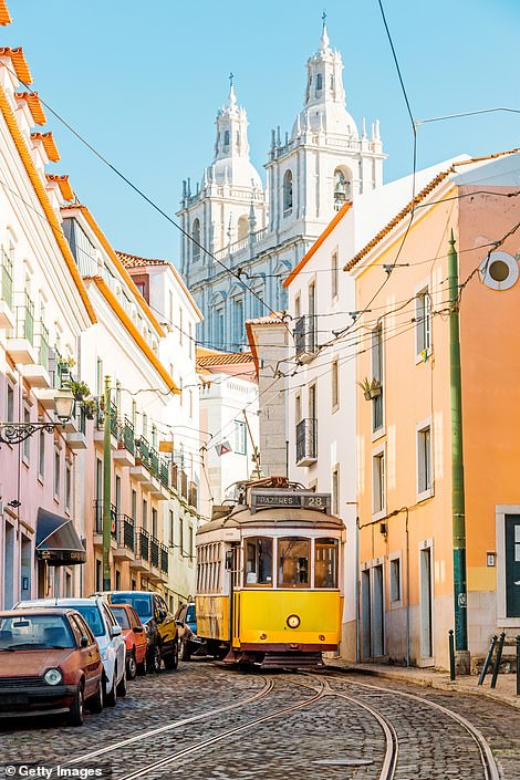 Iconic: Lisbon's trusty yellow trams, which rattle through the city