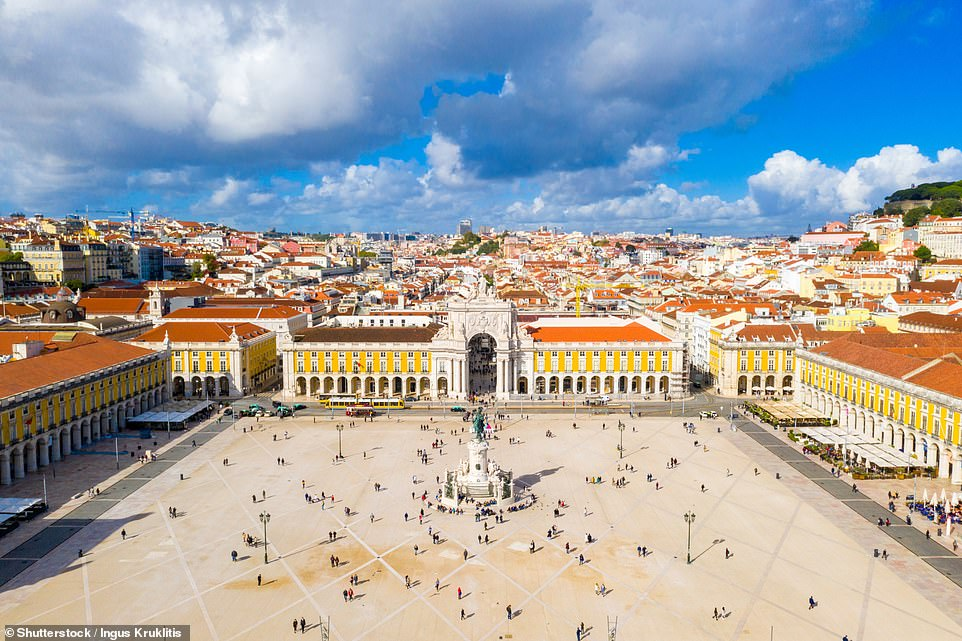 The Praca do Comercio in Lisbon, a perfectly symmetric masterpiece arcaded on three sides, with the fourth open to the River Tagus