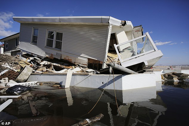 Experts say rising sea temperatures from global warming are making hurricanes more powerful and allowing them to move further and further inland before dissipating.