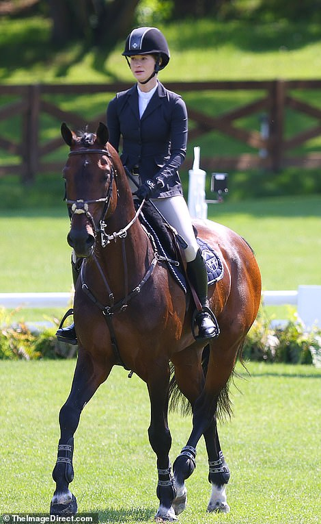 Pastime: She is pictured on her hourse at the competition in Westchester, north of New York City