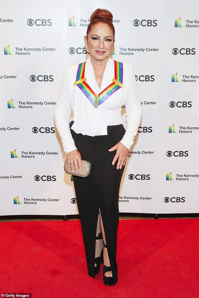 Host with the most: Hosting the scaled-back event was previous honoree Gloria Estefan, who wore a ruched white blouse with a black skirt and black platform heels