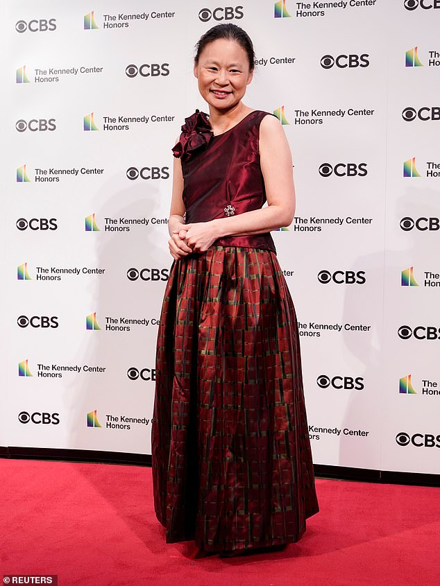 Virtuoso:The violinist Midori (born Midori Goto) showed off a crimson satin dress with a bow over one shoulder and a skirt featuring irregular stripes
