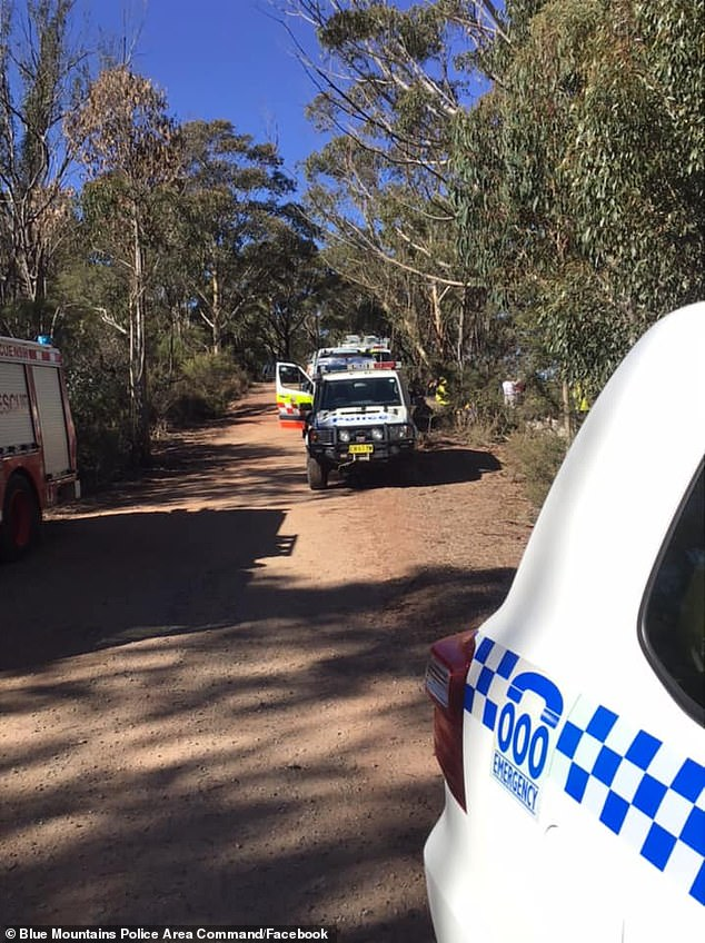 Police and rescue crew on the scene (pictured) after a boy, 15, reportedly fell 40m following an abseiling accident in the NSW Blue Mountains on Saturday morning