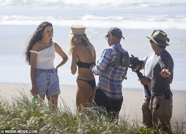 Genetically blessed pair: Jessica, who has her own fashion label called Johansen, accentuated her trim figure in a white one-piece swimsuit and denim shorts