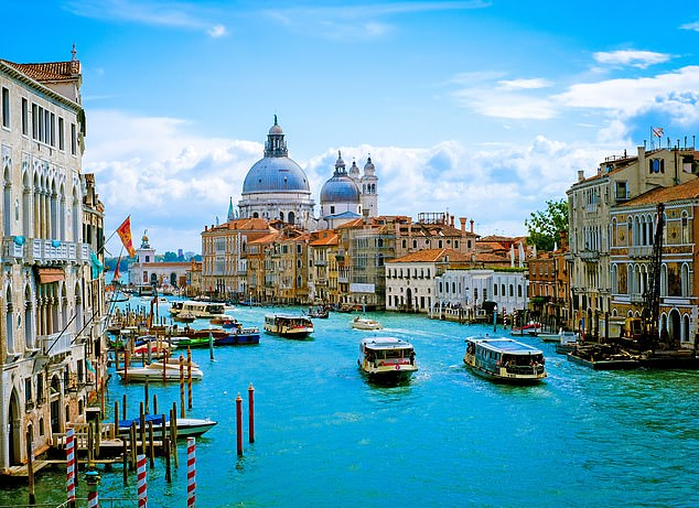 City of water: Flotillas of boats on the colourful Grand Canal of Venice