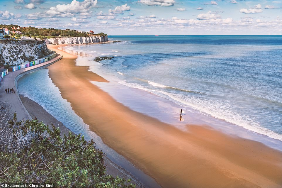 Seaside fun: Pictured is Stone Bay in Broadstairs, with its sandy beach, colourful beach huts and white cliffs