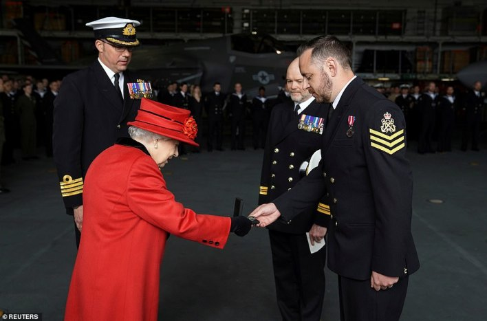 The Queen also presented the 15 years long service and good conduct medal to Petty Officer Matthew Ready (pictured) while she was visiting the HMS Queen Elizabeth on Saturday