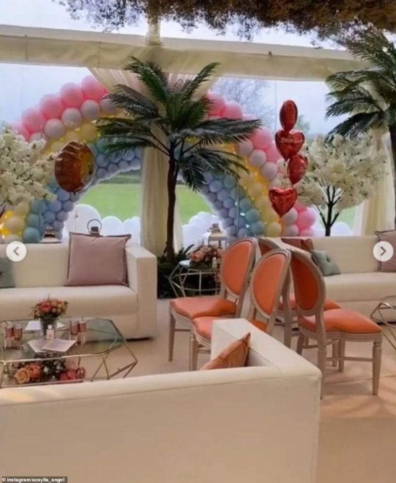 Touching: A rainbow balloon arch could be seen as well as lion and heart balloons inside the venue