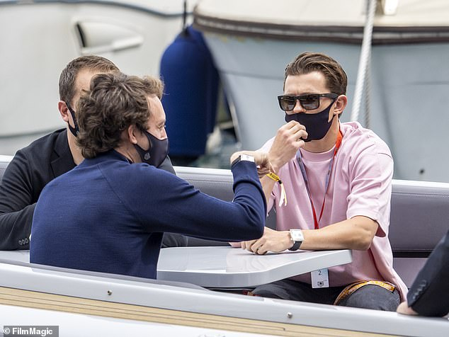 Racing ready: He accessorised with a large square faced watch with a black leather strap and sported his F1 wristband for easy access to the event
