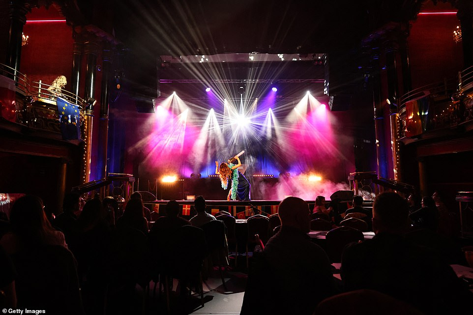 An artist performs on stage at The Clapham Grand night club in London as thousands of music fans prepare to watch the final