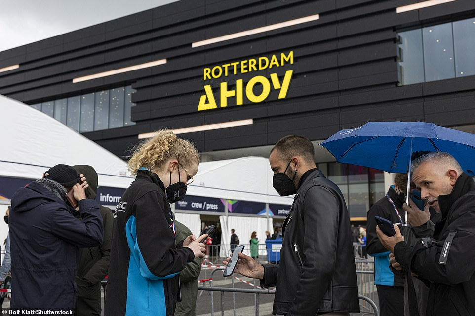 Crowds of fans wear face masks as they have their tickets check outside the Dutch venue ahead of the final tonight