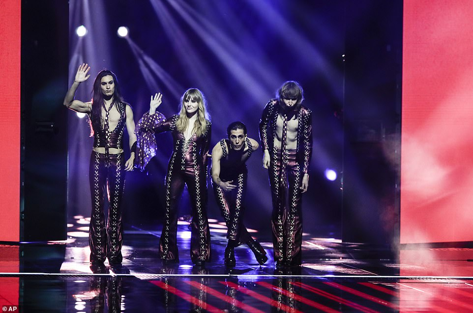 Italy's group, Maneskin, who are the favourites among bookmakers, wave to the live audience as they are welcomed on stage