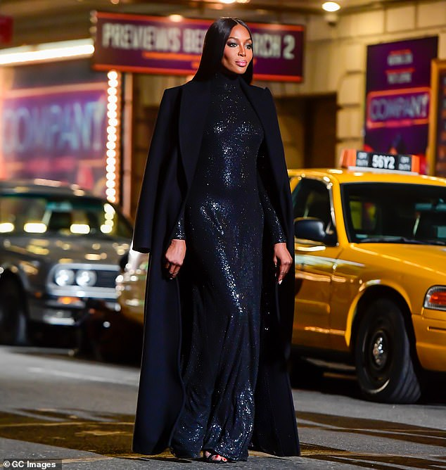 Surprise announcement! Naomi's baby news rocked fans after she appeared bump-less while walking in a Michael Kors fashion show in April, prompting many to think she used a surrogate; pictured April 8