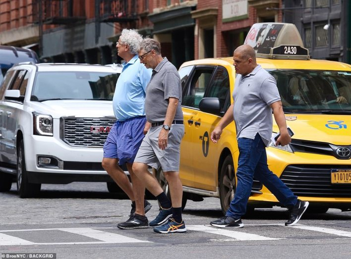 Bill Gates, 65, (center) was spotted in Manhattan on Saturday, after flying into Newark Airport in New Jersey the day before. He was walking in lower Manhattan with an unidentified friend and bodyguard