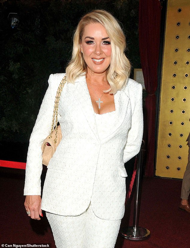 Stylish:Claire Sweeney, 50, put on a busty display as she rocked an all-white pant suit while heading to see Cabaret All Stars Presents Duncan James in London on Saturday