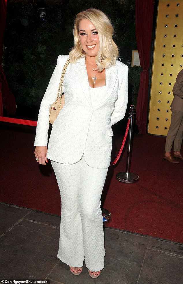 Glam: The Brookside actress opted for a figure-hugging white embroidered suit, including a double-breasted jacket, for the outing