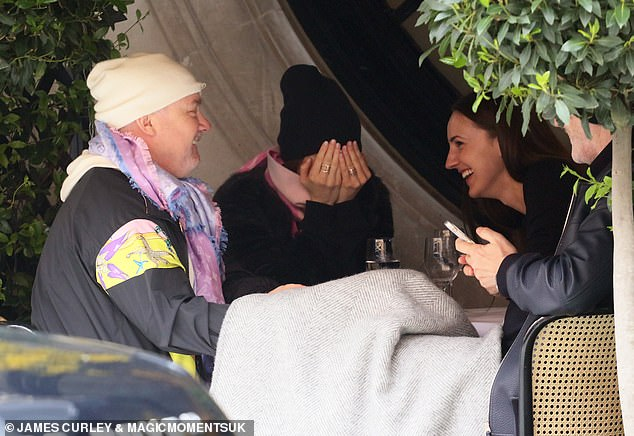 All laughs: Sophie covered her face while the others laughed at Damien's jokey behaviour