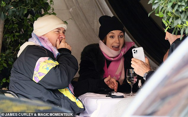 Wrapped up: Both Sophie and Damien donned scarfs and beanie hats to stay warm outside