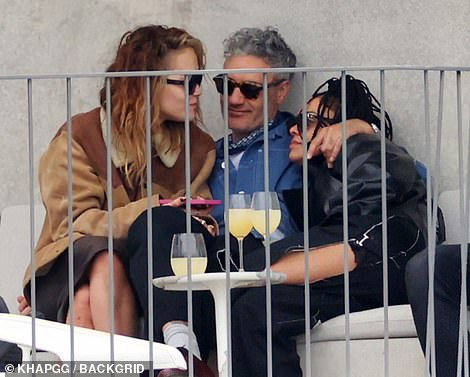 Relaxed: The trio seemed to be enjoying each others company as they chatted outside