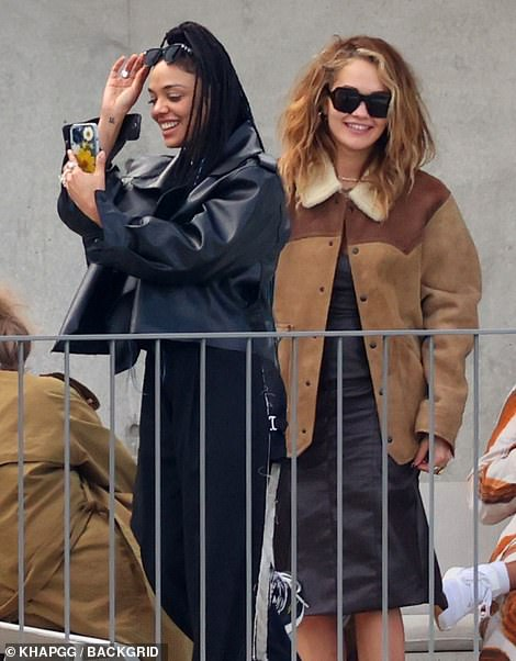 Picture time: Tessa and Rita seemed to be in good spirits as they snapped a few photos and looked at the phone screen
