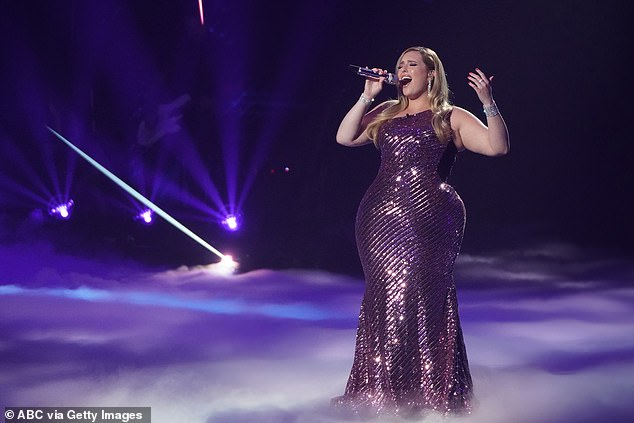 Kinstler's lavender one-shoulder sequin gown hugged her curves while she belted out a rousing rendition of Celine Dion's classic song, All By Myself