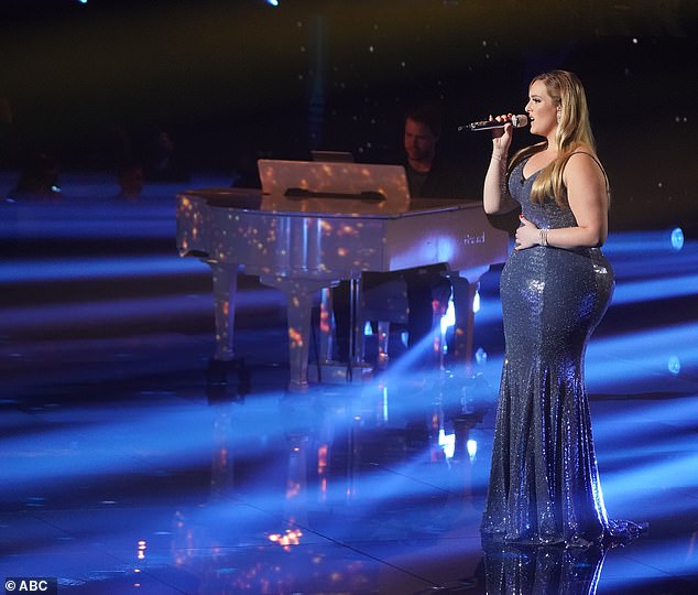Stylish: During the finale, she wore her blonde tresses long and straight for some of her performances during the three-hour finale