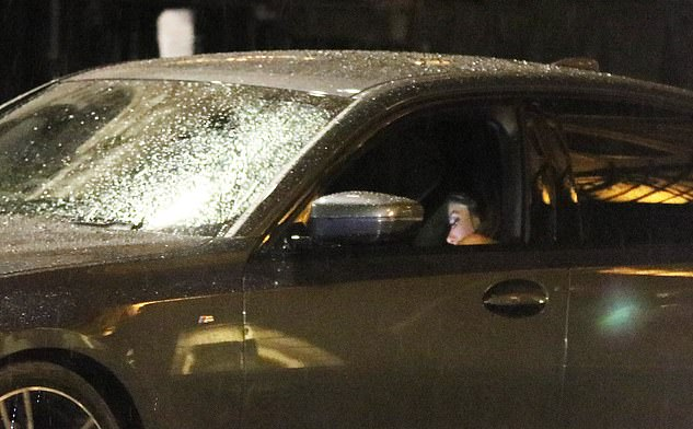 Leaving together: Frankie could be seen sitting in one of the back seats of Jack's car as he drove away
