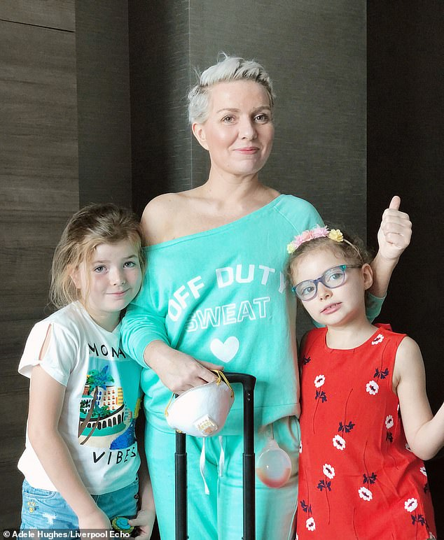 the mother-of-two has finished her treatment and shows no signs of disease, however, the cancer went into her lymph nodes, which means they cancer could lay dormant and will need to be monitored regularly (pictured going out of hospital with her daughters)