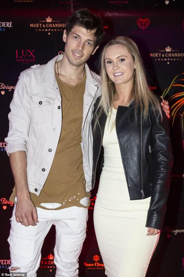 Looking good:The 29-year-old former Bachelor star looked chic in a fitted beige dress, over which she wore a black leather jacket