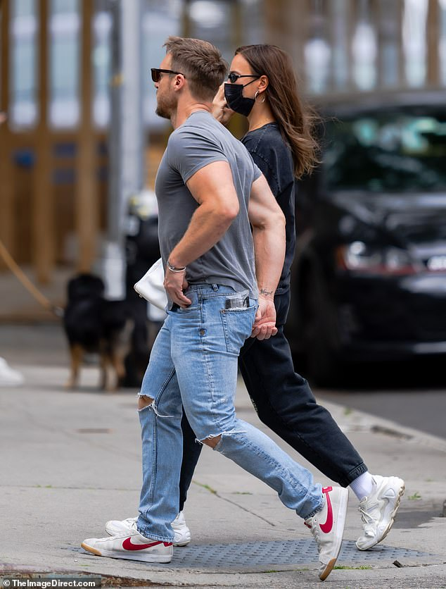 Keeping it casual: Jason donned a grey T-shirt and ripped jeans for the outing