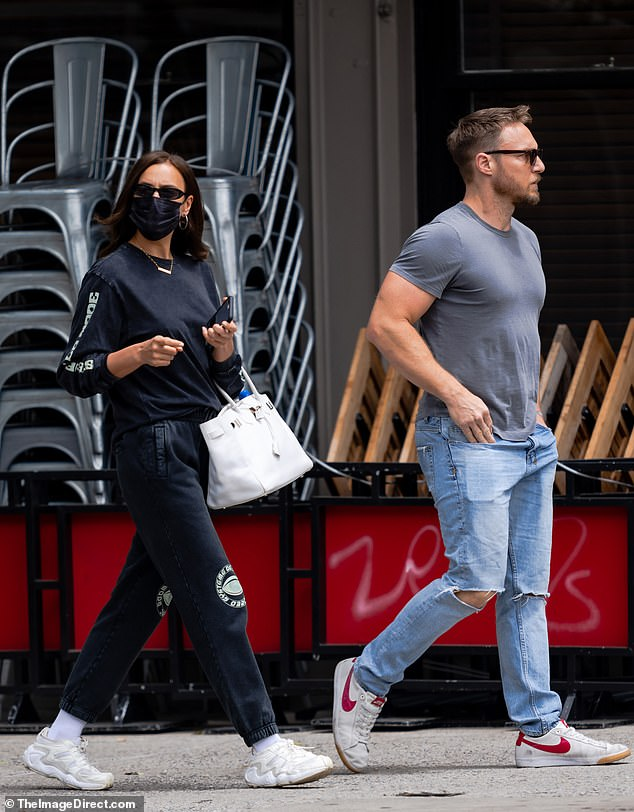 Fitness fanatics: The duo kept it casual for their outing, Irina in a black sweatsuit and sneakers