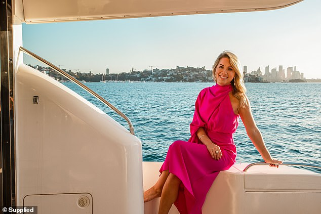 Pretty in pink:The former MAFS bride showed off her slim figure in a pink Sheike maxi dress, which featured a high neck and pleating on one shoulder