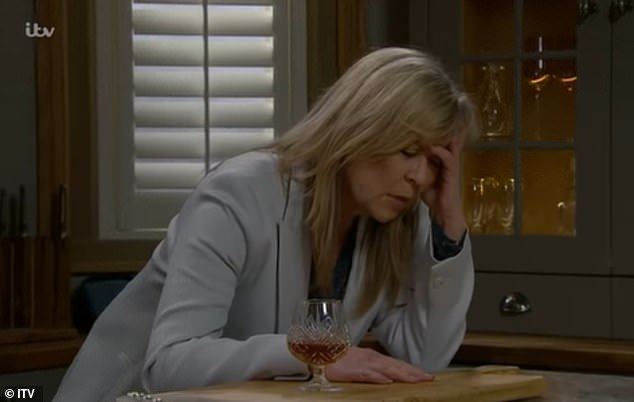Shocking:In recent weeks, soap watchers have seen an unidentified hand drop something into her brandy stash on multiple occasions, often leaving Kim feeling unwell
