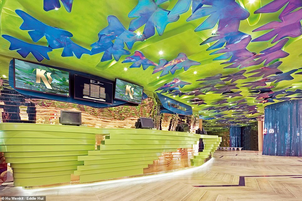 FUTURE AMAZON CINEMA, HUIZHOU, CHINA: This technicolour space is the foyer at the Future Amazon Cinema. Its official title is The Hall of Blue Butterflies and Golden Box Office. Wong explains that, in this area, 'movie-goers will not only feel a return to the origin of life but also experience a journey in which everything is infused with futuristic fantasies inspired by the Amazon'