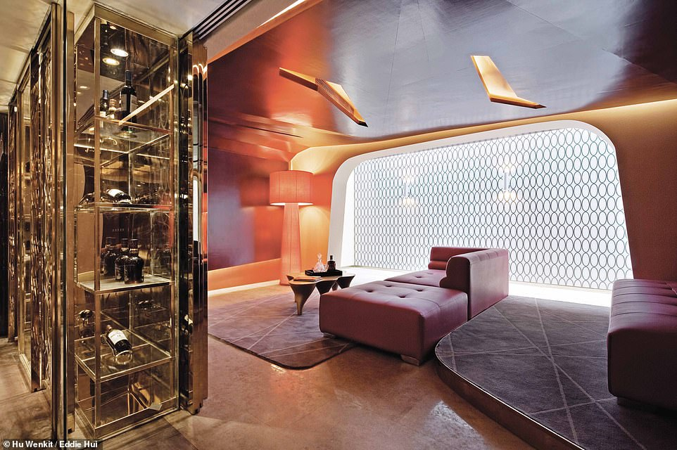 WHITE WINDSOR LUXURY HOME,JIANGSU, CHINA: Pictured is a home theatre in a luxury family home in eastern China. According to Wong, the objective in designing this home was to 'create high or royal living in China, a kind of super luxury'. He continues: 'With this intent, the design started with research on royal residences around the world in the hope of reinterpreting luxury living but with a slightly different narrative.' Elsewhere in this house, there are four bedrooms, a bar, a wine area and a gym