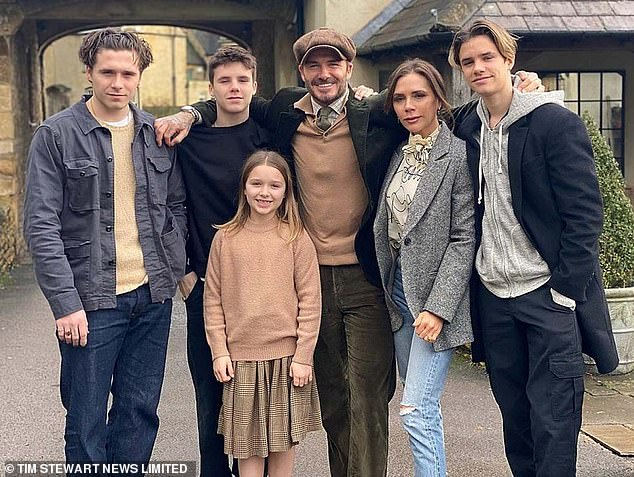 Happy days: The couple share sons Brooklyn, 22, Cruz, 16, Romeo, 18, and daughter, Harper, nine
