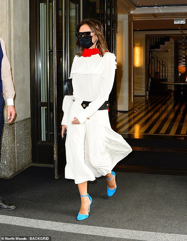 Chic: Fashion icon Victoria Beckham, 47, looked quirky yet stylish as she stepped out in New York wearing a long-sleeve ruffled dress on Tuesday
