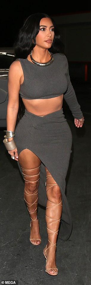 Kim, 40, wowed in a two piece charcoal set that put her flat midriff