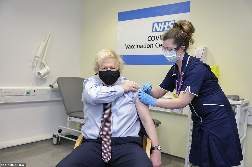 Boris Johnson (L) is given the Oxford-AstraZeneca COVID-19 vaccine by a nurse at St Thomas' Hospital in London, March 19