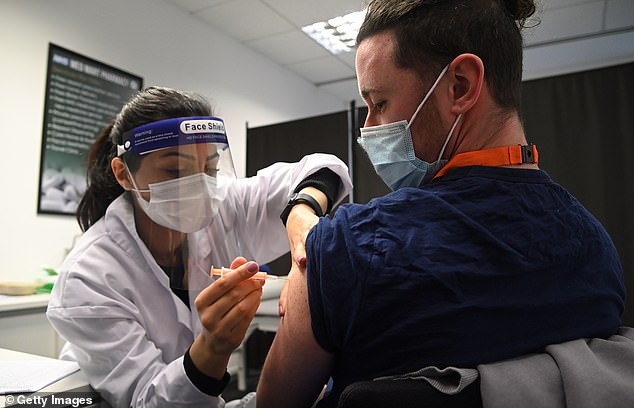 Doctors are being told to look out for signs of a stroke following the Oxford jab after three patients were admitted to hospital and one died (pictured: a care worker receives the Oxford/AstraZeneca vaccine in Borehamwood on February 15)