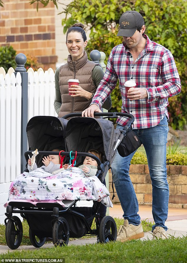 Casual:Lachlan, 35, dressed casually in jeans, a long-sleeve flannel shirt and sneakers as he pushed Lulu and Lottie in a stroller