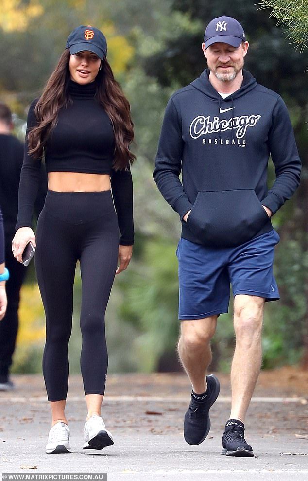 Trim and terrific:Alex wore a skin-tight crop top, matching leggings, grey sneakers and a black cap