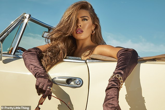 Beauty:She added a touch of luxury with brown satin gloves as she switched into another ensemble
