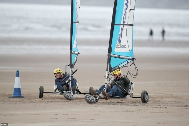 Tight corner: The couple were challenged with steering the wind-powered vehicles through a series of cones