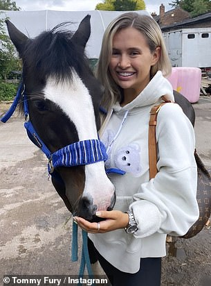 Animal lover: Tommy also showed off his girlfriend's love of animals with photographs of her with a horse