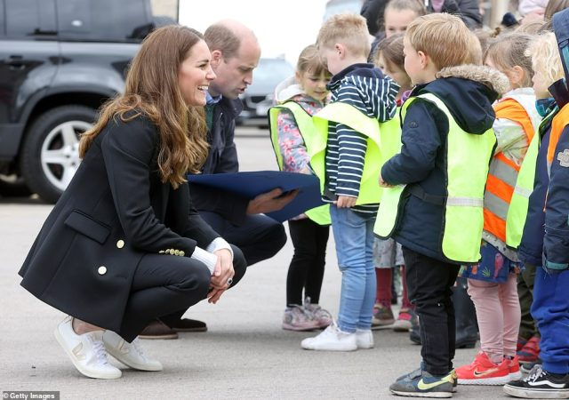 Listening ear: Kate beamed as she listened to the youngsters on the visit to the fishermen's families in Fife